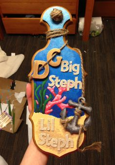 My paddle for my Big! I used acrylic paint and some rope-ish letters along with wooden letters, a wooden anchor, and twine! I left the sides and back bare because I love how pretty the wood looks! I was so happy with how it turned out! Big little Initiation Paddle Ocean anchor DG Delta Gamma