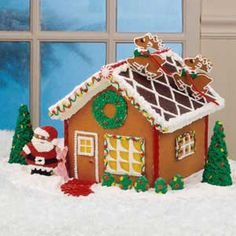 Love the idea of santa and reindeer on the roof of gingerbread house.