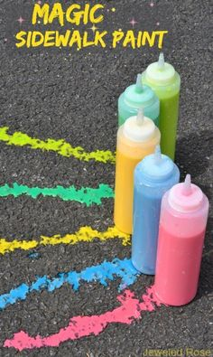 MAGIC Sidewalk squirty paint- this easy to make pint is so fun it kept my kids playing for a whole afternoon!