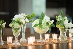 Nicki these are the cut crystal vases we would use.  I am really liking the vintage look with the candleholders as well.  What do you think?