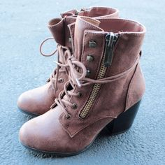 One of our customer's favorite is back! Stylish ankle boots that features a side zip, laced up front, and stacked heel. - man made material - imported - color: taupe, cognac, or black