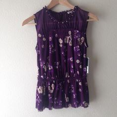 Juicy Couture Floral top Gorgeous purple top with a studded collar and soft, stretchy layered fabric for a feminine touch. Sheer purple for the top half and the straps and a button in the back to secure top. Make an offer(: Juicy Couture Tops Blouses