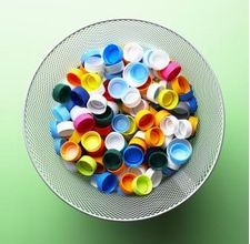 Using water and other plastic bottle tops for craft projects in the home - magnets, wind chimes, etc.