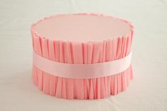 use styrofoam cake dummies & crepe paper streamers to create a perfect cake stand. tier different sizes for cupcake stands.