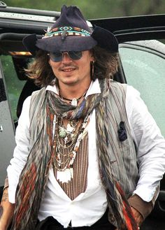 JOHNNY Depp stunned locals in Oklahoma when he showed up unannounced at a Native American parade. The movie star was made an honorary member of the Comanche Indian tribe earlier this year and was the guest of honor at their 21st annual Comanche Nation Fair in Lawton. Wearing a white shirt, waistcoat and hat, Johnny, 49, took on the role of parade Grand Marshall.