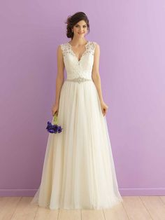 Romantic V-neck, A-line wedding dress with lace bodice, soft tulle skirt and embellished waistline by Allure Romance by @allurebridals