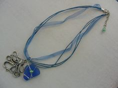 Blue Sea Glass and Octopus Necklace by cirquescreations on Etsy, $20.00