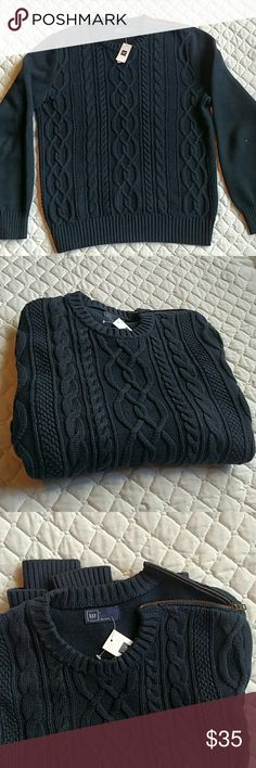 Gap cable knit navy sweater with zipper shoulder NWT cable knit sweater.  Zipper on the shoulder for that fisherman look.  This sweater is casual, comfortable, and had that utilitarian look all in one.  Get it for that person who loves to fish and fashion.  Or if they just like navy. GAP Sweaters Crewneck