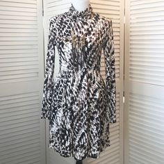 HP Tart animal print stretch knit dress Absolutely charming! Super soft stretch knit in a brown, black, and white animal print. Long sleeves, turtleneck. Fitted bodice, full skirt. Waist sits at natural waist in back and rises along the sides to become almost an empire waist in front--so flattering. Marked M but fits my size S (size 4) dress form perfectly. NWOT; never worn. Tart Dresses Long Sleeve