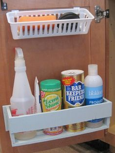 command hooks and plastic bin for sponges under the sink