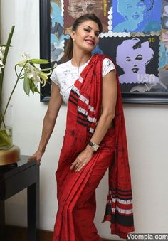 Jacqueline Fernandez's traditional look in a red sari and white blouse. via Voompla.com