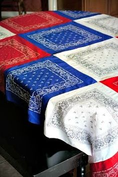 Make the perfect patriotic picnic tablecloth out of red white and blue bandanas! Perfect for 4th of July, Memorial Day, or all summer long!