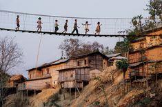 Steve McCurry, INDIA. Mizoram, 2006. Children cross bridge.