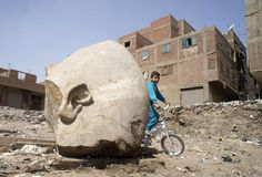 CAIRO (AP) — Archaeologists in Egypt discovered a massive statue in a Cairo slum that may be of Ramses II, one of the country's most famous and longest ruling ancient pharaohs.The colossus, a large portion of whose head was pulled from mud and groundwater by a bulldozer and seen by The #Archaeologists, #Cairo, #Discover, #Egypt, #In, #Massive, #Slum, #Statue