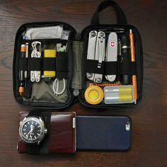 Omega Planet Ocean XL Valentini wallet iPhone 6 Maxpedition mini pouch Noname micro screwdriver combo Leatherman Style CS Cricket lighter electric band Leatherman Rev Victorinox Pioneer Range, Alox, Farmer Fenix AA LD09 5201 Koh-i-noor automatic pencil Bckup AA battery 1m Metric Tape Measure matches