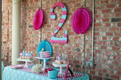 """cute """"2"""" that's really easy to make... just cut out a cardboard and cover it with crepe paper"""