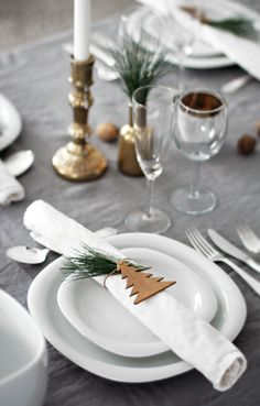 Use a grey linen tablecloth, then decorate your table with gold (spray painted) vases and candle holders to add a bit of glam. Finally add some cute cinnamon trees to your napkins!