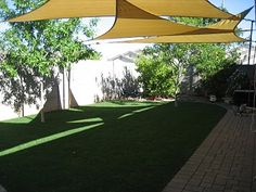 simple tensile shade. i'd love this in our back yard.