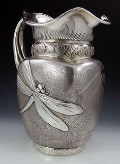 Rare and Important Whiting antique sterling pitcher with dragon and fly and irises