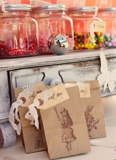 cute candy jars and paper sacks