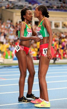 (L-R) Gold medalist Tirunesh Dibaba of Ethiopia and medalist Belaynesh Oljira of Ethiopia celebrate after the Women's 10000 final during Day Two of the 14th IAAF World Athletics Championships Moscow 2013 at Luzhniki Stadium on August 11, 2013 in Moscow, Russia.