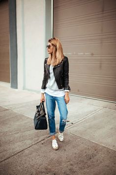 Cristina Monti keeps it cool and casual in a pair of distressed boyfriend jeans, paired in the classic style with a white tee, sweater, and a leather biker jacket. Try this style with a pair of patterned shoes to capture this look!  Jacket: Zara, Jeans: J Brand.
