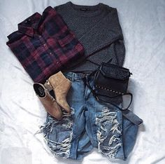 Flannelette, smoke knitted sweater, ripped blue jeans, brown ankle booties and black handbag