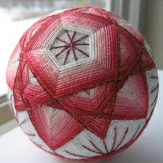 Temari is an ancient folk art form originating in China and later introduced to Japan by traveling Chinese monks.
