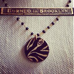 BurnedinBrooklyn custom order wooden pendant with Zebra print back. Visit www.etsy.com/shop/BurnedinBrooklyn for custom orders.