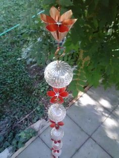 Copper Lotus Origami Rain Chain with Optic Glass Reflecting Balls. $185.00, via Etsy.