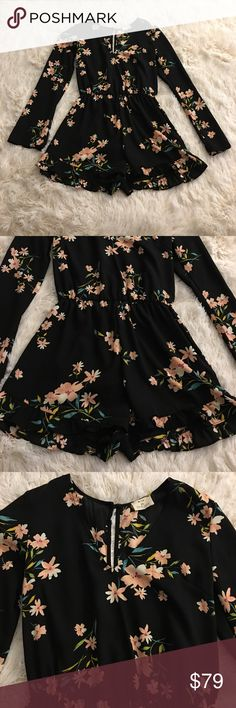 Cute black floral romper 🚫No Trades🚫 Rare Kimchi Blue romper from UO. Wore out once. 10/10 condition. Could also fit a petite small. Button closer in the back, elastic waist, open slit down the back Urban Outfitters Other