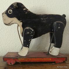 Sweet antique pull toy; gave one of these to my daughter because of her Boston Terrier.