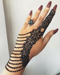 What is a Henna Tattoo? Henna tattoos are becoming very popular, but what precisely are they? Henna Hand Designs, Arabic Bridal Mehndi Designs, Mehndi Designs Finger, Mehndi Designs For Girls, Modern Mehndi Designs, Mehndi Design Pictures, Beautiful Mehndi Design, Tattoo Designs, Mehandi Designs