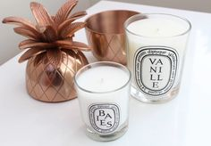 My favourite candle brand – Diptyque Paris. Diptique paris candles of Roses Diptyque candle, Mimosa Diptyque candle, Baies Diptyque candle. Bathroom decor, marble and copper. Diptyque candle storage DIY. Oliver Bonas Rose Gold copper pineapple. Diptyque flatlay