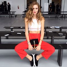 Chiara Ferragni in Calvin Klein Crop Top and Trousers, Yves Saint Laurent Bag…