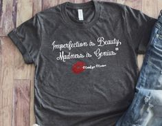 Marilyn Monroe T Shirt, Marilyn Monroe Quote, Imperfection is Beauty Madness is Genius, Hot Lips, Fa Marilyn Monroe T Shirts, Marilyn Monroe Quotes, John Wayne Quotes, Imperfection Is Beauty, Mother In Law Gifts, Plus Size T Shirts, Hollywood Star, How To Make Tshirts, Birthday Gifts For Girls
