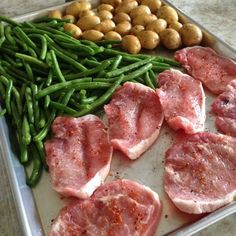 An easy sheet pan dinner idea from @tiffanyaking Place boneless pork chops, green beens and potatoes on a sheet pan, then sprinkle with olive oil and seasoning.