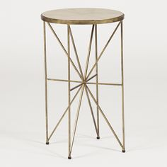 This small drinking table is the perfect accent piece. Adorning the brass iron starburst shaped base is a unique faux-horn top in a geometric pattern.