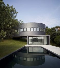 This house by Spanish architects Subarquitectura spirals down a sloping site in Madrid. #Architecture