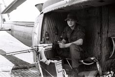 "...  seen in the picture is ""chicken plate"" chest armor, and a ""monkey strap"" to keep the huey door gunner from falling out of the aircraft. Description from vhpamuseum.org. I searched for this on bing.com/images"