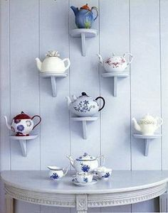 Great way to display tea cups / teapots on a wall!                                                                                                                                                                                 More