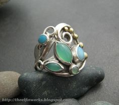 Ring, green chrysoprase, blue opal &  turquoise, handmade sterling silver, flowing vines leaf design, several stones, size 10 and 1/4. $200.00, via Etsy.