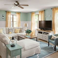 think I could paint the paneling white in our house, and do this in a spare bedroom instead of ripping the paneling down. Love the contrast between the light blue and white and then the pop of color with the curtains.