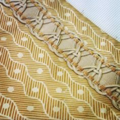 Printed shantung curtains edged with a coordinating trim.