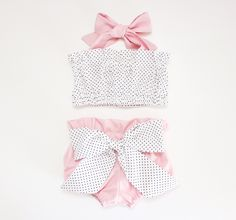 This is the most adorable playsuit for babies and toddlers. The top is a halter tie back and the bloomers are high waisted. Made from 100% cotton. Both are ruffled along the top and the bloomers have an adorable bow on the bum. You can purchase each piece individually or as a set, just select your choice from the drop down menu. Please visit our FAQ page for current production and ship times. These fit true to size, but you can visit our FAQ page for size charts based on weight.