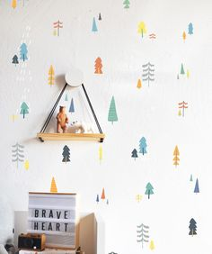 15 Decor Ideas For Creating A Woodland Nursery Design // Small colorful tree wall decals create a more subtle but equally as adorable woodland setting.