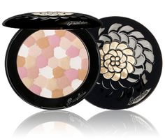 Guerlain Météorites Wulong pressed powder- I picked this compact up and it has been pretty awesome. In my opinion, it is the best setting powder for my dry dull skin. I need that dewy glow and subtle sheen/shine to mke myself look healthy. I also have the permanent meteorites in the loose balls. This is my first compact. The case is like jewelry. It's a hefty price but it's refillable so it will be a treasure for your lifetime. A great hand me down and a true piece of artwork.