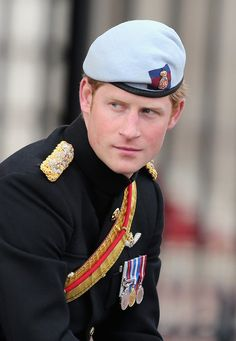 Prince Harry returns to Buckingham Palace during the annual Trooping the Colour Ceremony on 15 June 2013 in London, England