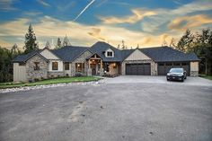 The Ascension - House #4 from the 2016 Clark County Parade of Homes built by Cascade West Development with Interior Design by Creative Interiors & Design - Front Elevation of this award winning #SuperRanch custom home