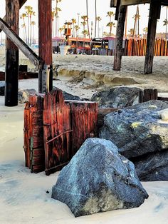 Every once in a while, the high surf will uncover what appears to be the possible remains of the original McFaccden Wharf built long before the Newport Pier was constructed. Newport Pier, Firewood, Surfing, California, Construction, The Originals, Building, Woodburning, Buildings